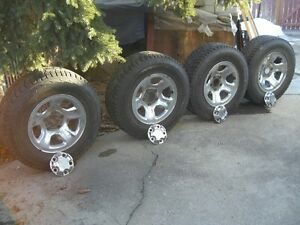 FOUR LT 265-70-R 17-INCH HANKOOK TIRES ON RIMS