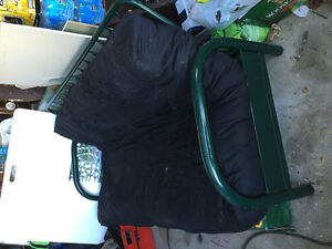 Green metal futon frame with black mattress
