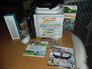 Wii with 21 games, wiimote, nunchuk, 2 wheels