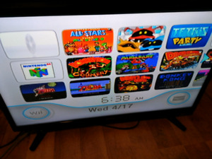NINTENDO WII WITH MANY RETRO GAMES INSTALLED