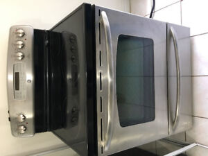 """Almost new GE stainless steel 30"""" electric glass top stove range"""