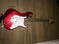 Red Yamaha Pacifica guitar with Marshall amp
