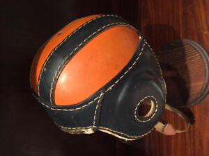 Leather junior football helmet with stand