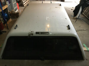 White Truck Cap off Ford truck. 6 1/2 ft box