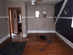 Clean quiet room to rent in a two-story house for lady
