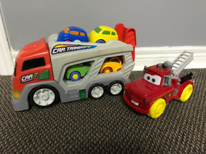Transporter truck with cars and Tomater fire truck bath toy