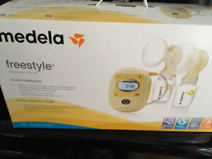 Medela Freestyle breast pump (used) with bonus