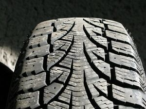 4 Pirelli Winter Carving 185/65R14 on steel rims w/wheel covers West Island Greater Montréal image 7