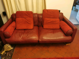Red leather corner style sofa.