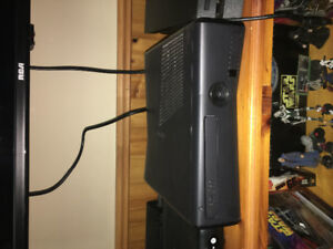 Xbox 360 + 1 controller +  chat pad + 17 games. Open to offers
