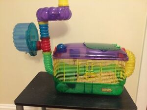 Hamster with cage.