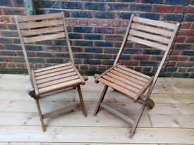 Two Wooden garden chairs set