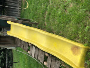 Playground plastic yellow slide.