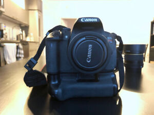 Canon T4i with 2 lenses, SD card, battery grip, and camera bag