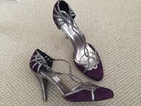 Purple and silver high heeled shoes