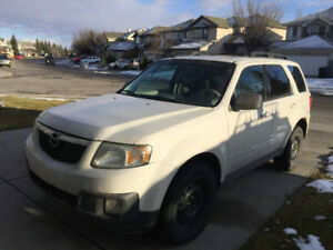 2009 MAZDA TRIBUTE & STUDDED TIRES