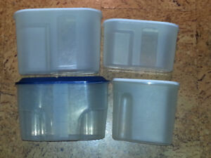 4 plastic containers with lids