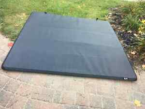 F150 Tri-fold Truck Bed Tonneau Cover (Freedom by Extang) London Ontario image 1