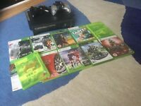 Xbox 360 with 10 games and 2 remote controls