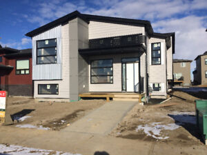 New 2 bedroom lower level behind Chinook High