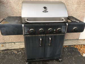 Uniflame BBQ with 4 burners. It needs some TLC