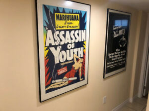 Two Framed Posters