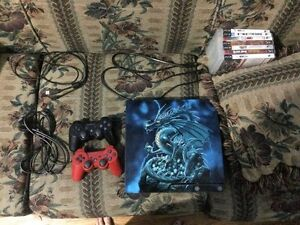 PS3 w/ skin, 2 controls & games
