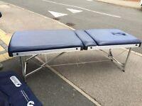 Portable massage table with Nylon bag & books