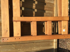 Solid Wood Bunkbed Double on the bottom single on top.