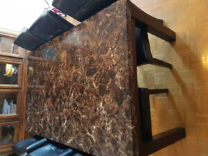 1 Year old Marble top dinning table and 6 lather chair