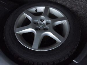 Nissan Good Year 4 Winter Tires on rims from Nissan Altima