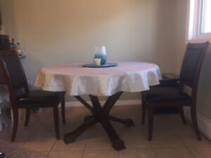 LOW PRICE!!  Dining room table and 2 chairs.