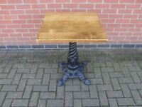 Wooden top table with cast iron base
