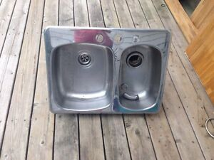 Double kitchen sink with garburator