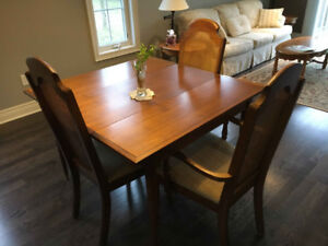Dining Room Table and three chairs.