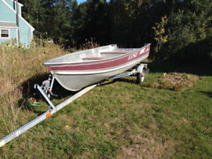 14' Lund Deep Hull with 9.8 HP Nissan four stroke and trailer