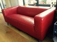Red IKEA 'Klippan' sofa