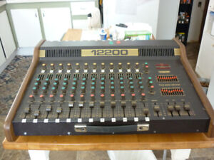 12/200 traynor mixing board--and peavy 300 monitor amp