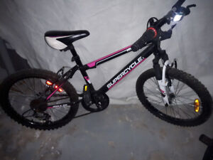 Girls pink and black mountain bike