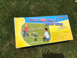 BOUNCE GO ROUND TEETER TOTTER - NEVER USED, IN BOX - SPINS 360°