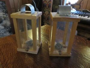 PAIR OF CANDLE LIGHTS MADE AT FORT WILLIAM HISTORIC PARK asking
