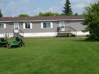 PRICE REDUCED - NEW HOME ON 2 ACRES EAST OF YORKTON