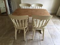Lovely country kitchen table with 4 chairs.