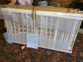 Brand new white cot for sale