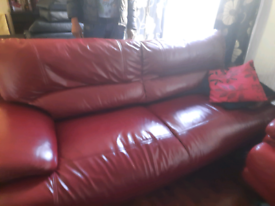 Two red leather sofas