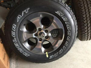 Stock 2018 set of 5 Wrangler Sahara Tires and Rims(never used)