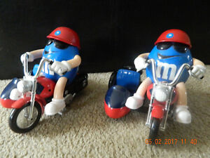 M&M on motorcycle with side car