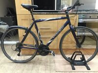 Trek Fx7200 Hybrid Road Bike. 700cc Wheels. 24 gears ! Back wheel is buckled slightly