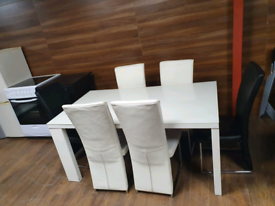 35. High gloss table and 6 leather chairs