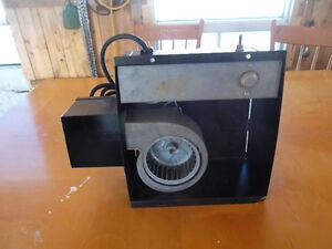Wood stove blower fan.